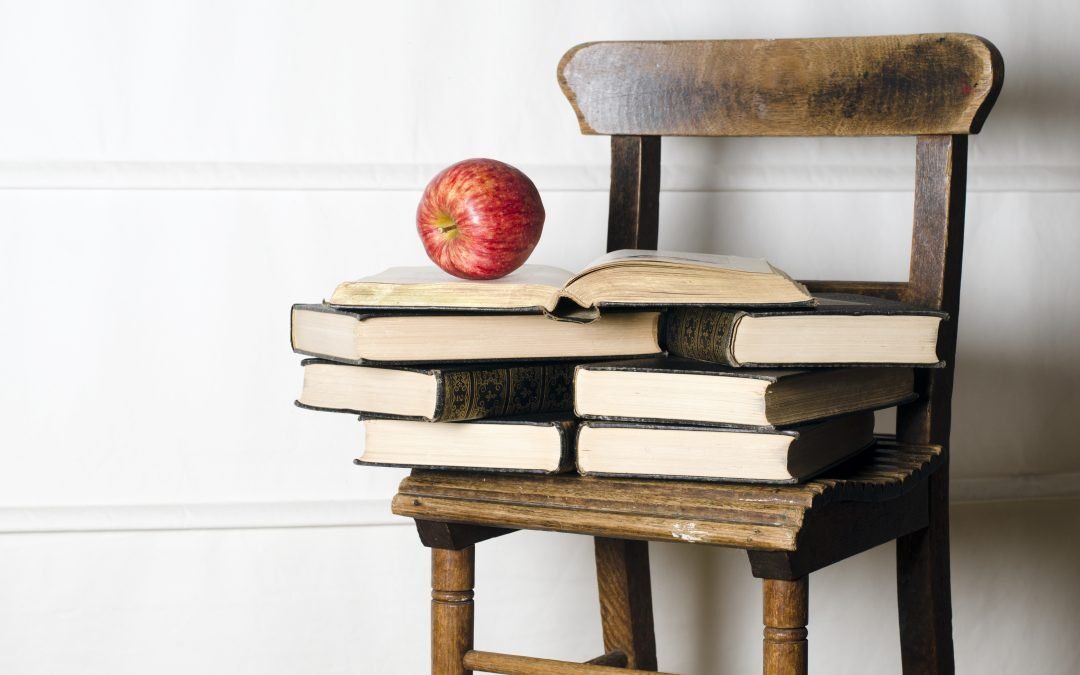 Classroom chair with apple and books
